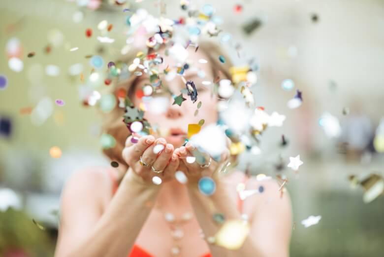 Girl-Blowing-Confetti.jpg