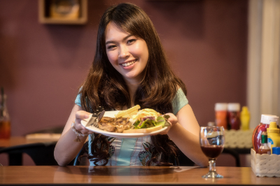 Canva - Asian Girl Showing her Food.jpg