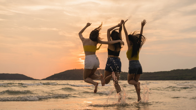group-of-three-asian-young-women-jumping-on-beach_7861-1855.jpg